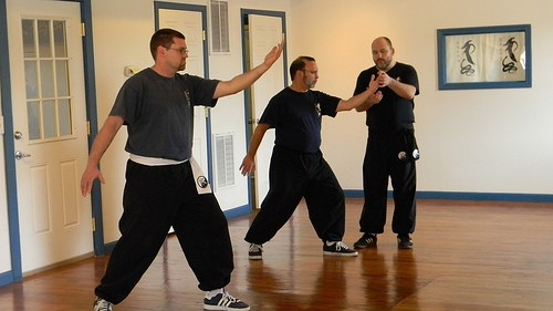 Wes learning a Tai Chi self-defense application from his teacher, Master Sbarge (left)