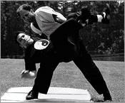 Master Sbarge (back) teaches Sifu Wesley Adams a Tai Chi Self-Defense application.